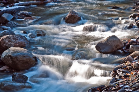 A babbling brook wanders past rocks in upstate New York