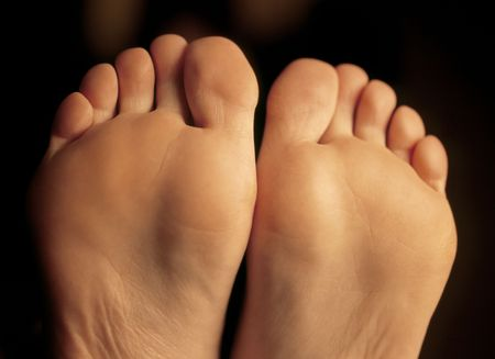 Shallow depth-of-field image of the bottom of a females feet.