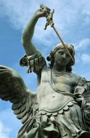 Statue of St. Michael on the top of Castel Sant' Angelo, in Rome Italy.