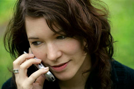 Headshot of a pretty female talking on her cellphone.