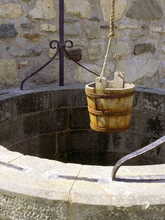 A water well with an old bucket in Fort Louisburg, Nova Scotia, Canada.