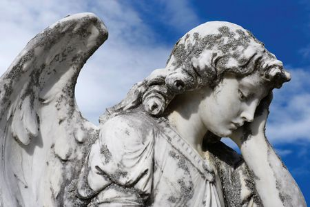 Statue of an sad angel.  Sculpture was on top of a gravestone from the 1800's.