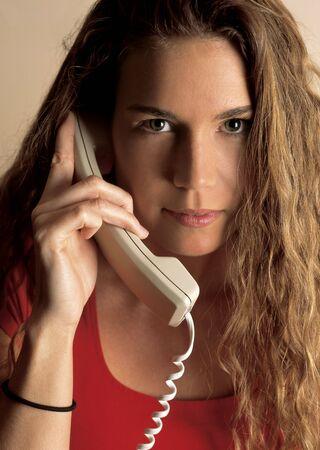 Beautiful female talking on the phone.