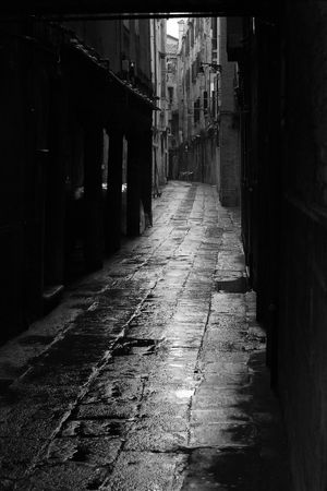 Dark alley in the rainy streets of Venice, Italy.