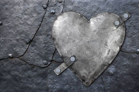 Photo of a galvanized metal heart bolted to old hammered metal plates with rivets.