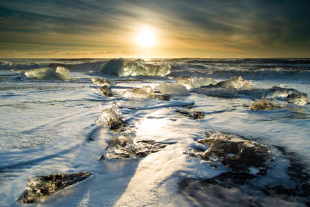 Taken at Breidamerkursandur by the outlet of Jokulsarlon in Iceland  Ice brought down from the lagoon melting on the black beach is constantly hit by the surf