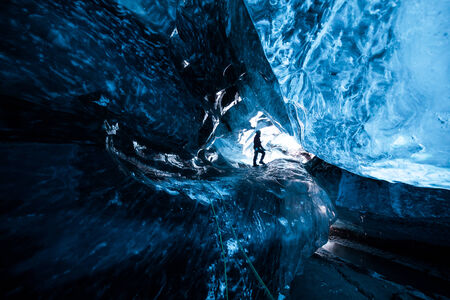 Cave explorer in an icecave in Iceland