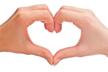 Photo pour heart shape made of two woman's hands. Isolated on white - image libre de droit