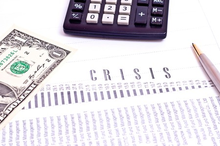 Crisis graph with calctulator and silver pen isolated on white