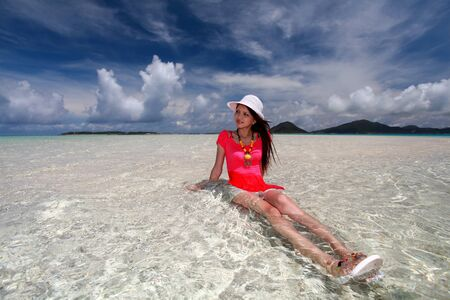 The woman who relaxes on the beach