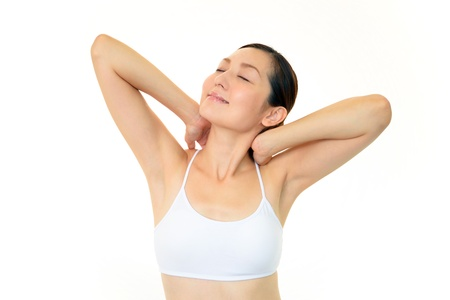 Beautiful woman doing stretching fitness exercise