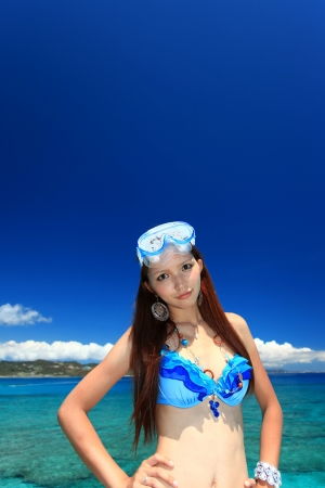young woman on the beach enjoy sunlightの写真素材
