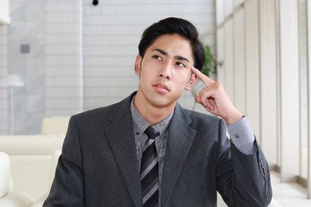 Portrait of businessman looking uneasy.