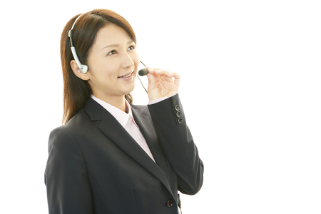 Photo for Smiling call center operator - Royalty Free Image