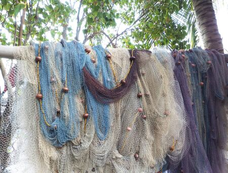 Foto de Fishing nets of different sizes and colors hanging and drying. Caribbean and tropical background. - Imagen libre de derechos