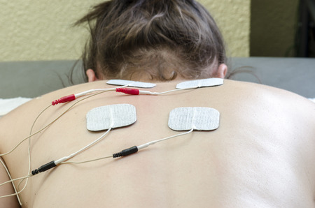 Photo pour TENS electrodes positioned for back pain treatment in physical therapy. - image libre de droit