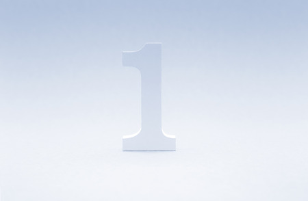 Number one on blue background. Top concept. Wooden number1 as symbol of success