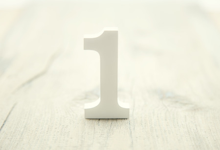 Number one on rustic wooden background. Top concept. Wooden number 1 as symbol of success