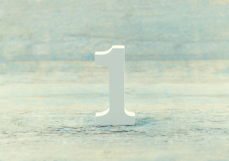 Number one on rustic wooden background. Top concept. Wooden number1 as symbol of success