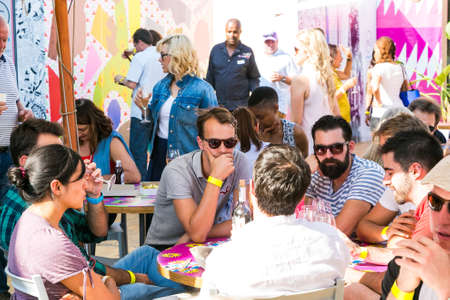 Photo pour Johannesburg, South Africa - October 15 2016: Diverse Friends eating, drinking and generally enjoying a day out at a Food and Wine Fair - image libre de droit
