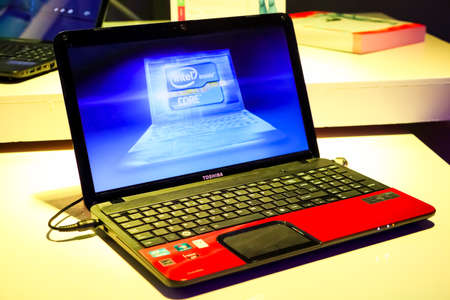 Photo pour Johannesburg, South Africa - June 21, 2012: Toshiba Laptop on display with bright colorful lighting - image libre de droit