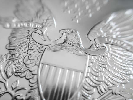 Photo pour Macro close up of a American Eagle pure Silver Bullion coin. Used as a means of exchange and a store of value - image libre de droit