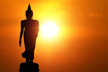 Photo for Magha Asanha Visakha Puja Day , Silhouette Buddha on golden sunset background. - Royalty Free Image