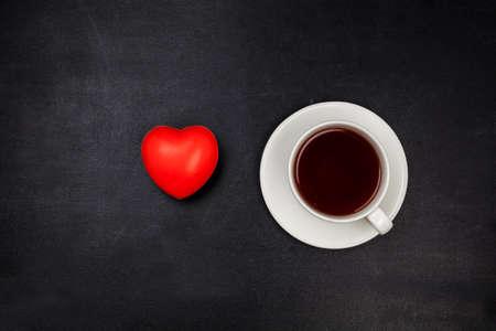 Photo pour Cup tea on black surface. Top view. - image libre de droit