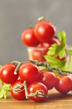Photo for Fresh cherry tomatoes on a wooden table. Selective focus - Royalty Free Image