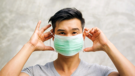 Photo for Asian man wears a protective mask. - Royalty Free Image