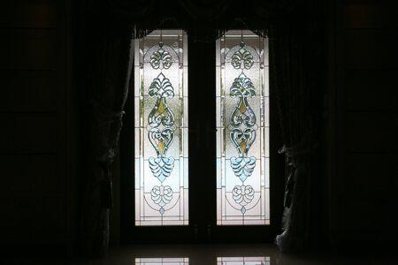 Foto de Colourful stained glass wooden door of a traditional . - Imagen libre de derechos