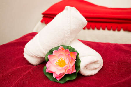 Photo for Clean towels on bed in spa room - Royalty Free Image