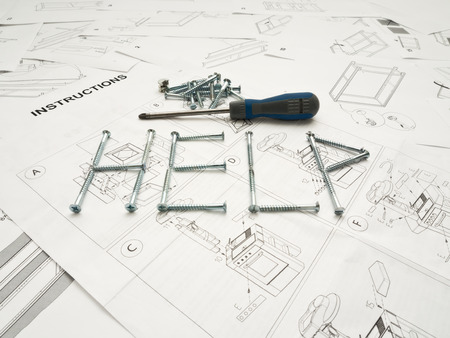 Word help made of screws over instructions manual with screwdriver