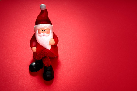 christmas santa claus figurine on a red background