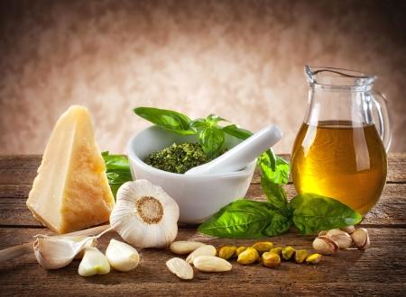 Sicilian pesto ingredients on wooden table