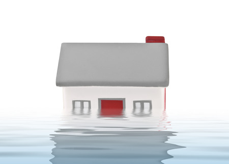 House model plastic submerged under water on white background