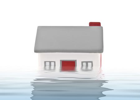 House model plastic submerged under water on white background