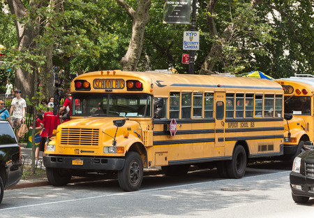 NEW YORK CITY, NY, USA - JULY 07, 2015: School bus in Manhattan. NYC has the largest school transportation department in the country.