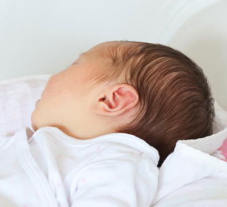 Photo pour Small delicate little ear of newborn baby girl. - image libre de droit