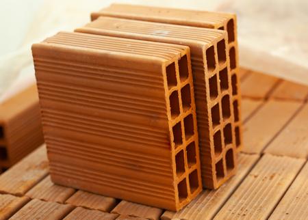 Foto de Masonry wall bricks. Building construction concept. - Imagen libre de derechos