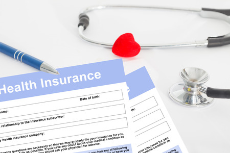 Photo for Health insurance form, questionnaire with stetoscope and red heart for insurance concept - Royalty Free Image