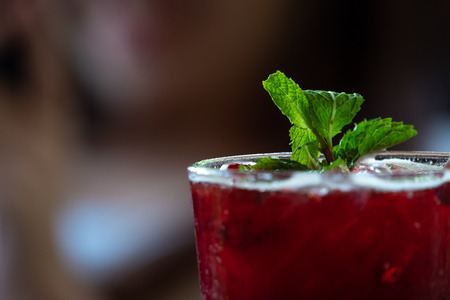 Photo pour Fresh red juices, sweet and sour taste, placed on a blurred background. - image libre de droit