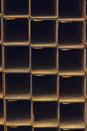 Metal profile pipe of rectangular cross section in packs at the warehouse of metal products, Russia