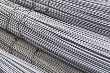 Photo pour Reinforcing bars with a periodic profile in the packs are stored in the metal products warehouse, Russia - image libre de droit