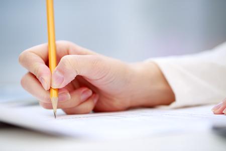 Photo pour Female hand writing, close up - image libre de droit