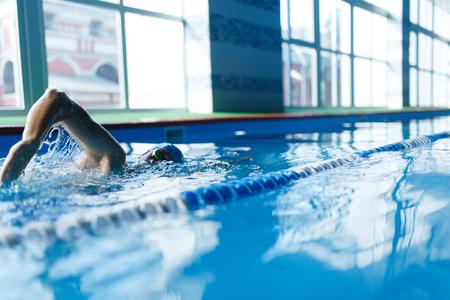Foto de Image of sports man swimming in pool indoors - Imagen libre de derechos