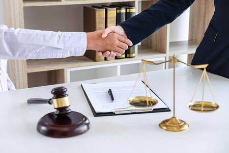 Photo pour Handshake after good deal negotiation cooperation, Professional female lawyer or counselor and client meeting, working with legal case document contract in office, law and justice, attorney, lawsuit. - image libre de droit