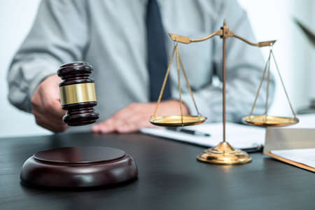 Photo pour Male lawyer working with legal case document contract in office, law and justice, attorney, lawsuit concept. - image libre de droit