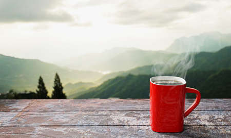 Photo pour freshly brewed coffee or espresso into a red cup and coffee mug. Hot coffee in a mug placed on the tabletop or wooden balcony. Morning mountain view, morning sunshine. 3D Rendering - image libre de droit