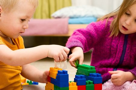 Children are jointly building a toy house